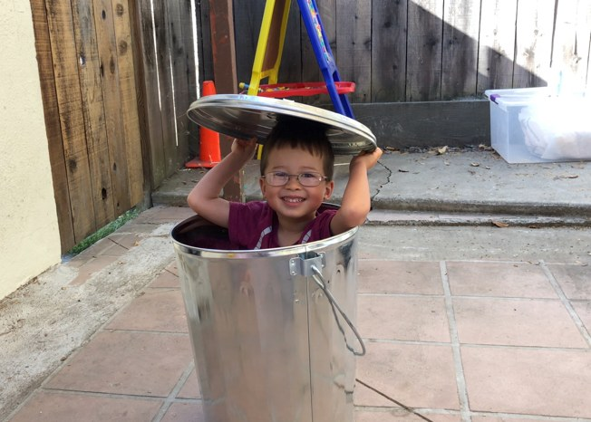 Kid in trash can